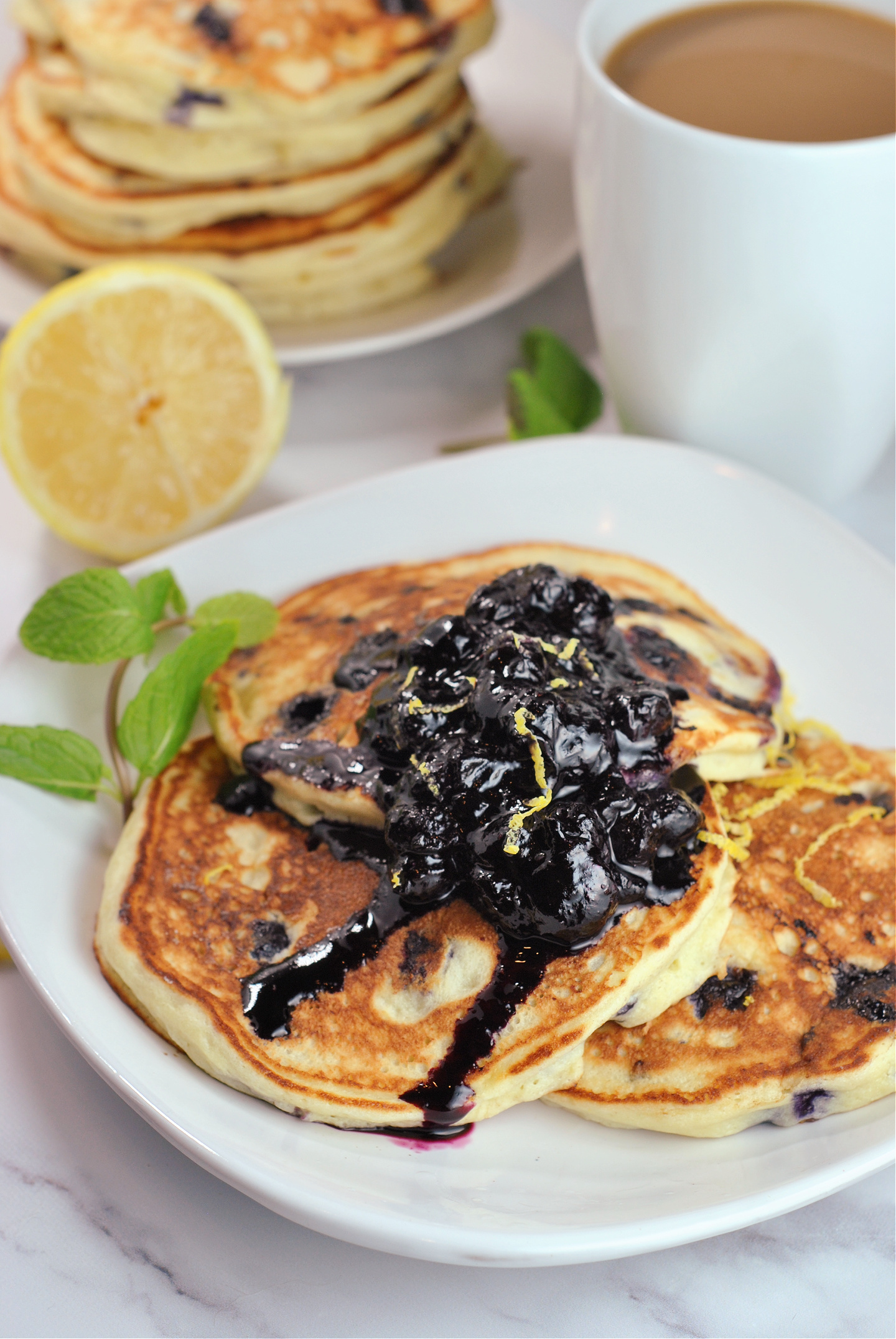 Lemon Ricotta Blueberry Pancakes with Blueberry Compote via @preventionrd