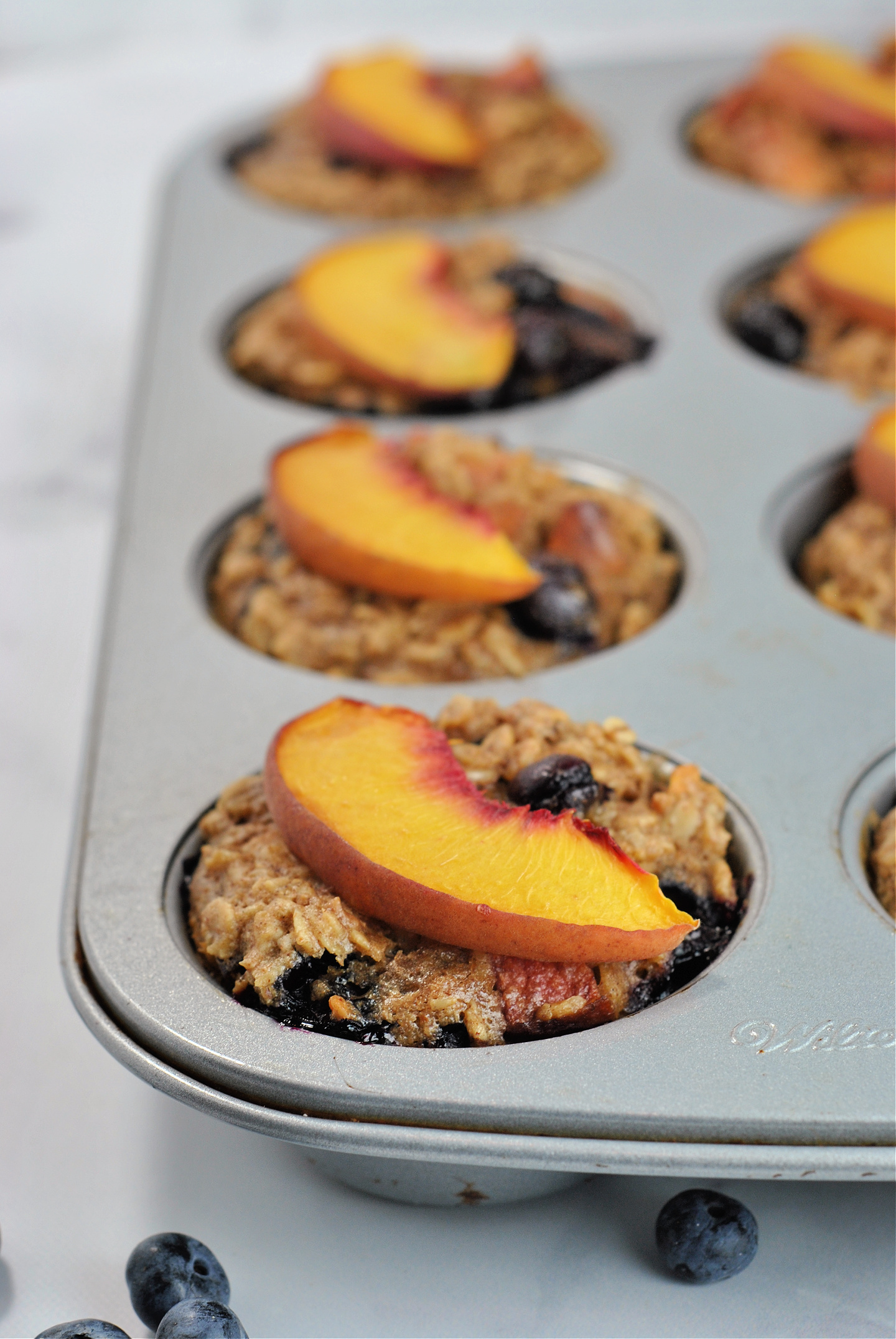 Almond Butter Peach Blueberry Oatmeal Cups via @preventionrd